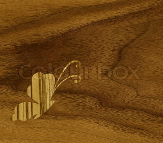 Marquetry, butterflies of zebrano veneer against the background of teak wood