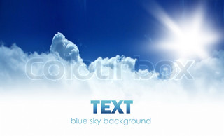 Blue sky background border with fluffy clouds, bright sunshine & copyspace