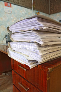 heap of the papers on table in office