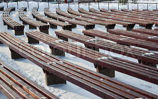 Benches in empty concert under the winter sky