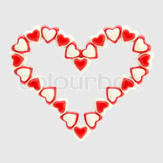 Valentine symbol made of bright glossy hearts isolated on grey