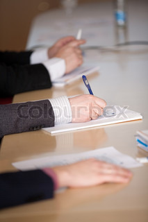 Male hands make notes on a conference