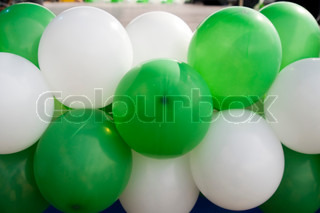 Bunch of colorful balloons Green and white balloons
