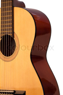 Classical acoustic guitar, isolated on grey background