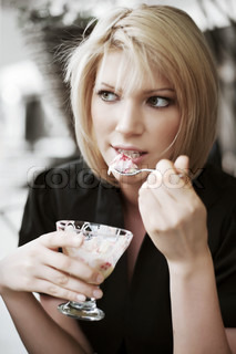 Young woman eating an ice cream