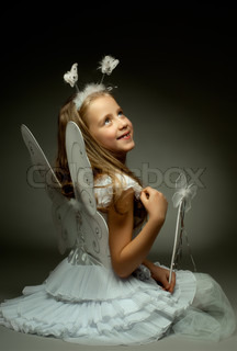 little girl with wings, sit and