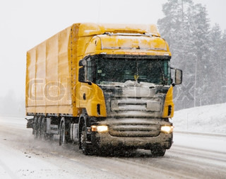 a moving truck during a heavy snow