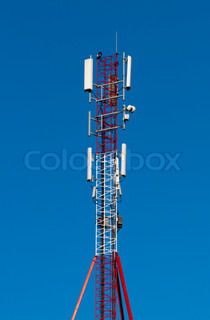 High resolution image. Detail of a transmitter tower against clear blue sky.