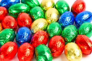 close up of chocolate easter eggs in colorful foil