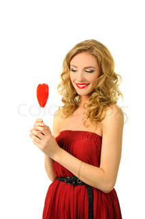 Sexy valentine girl holding red heart candy