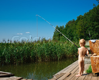 young child fishing from a pier in the pond