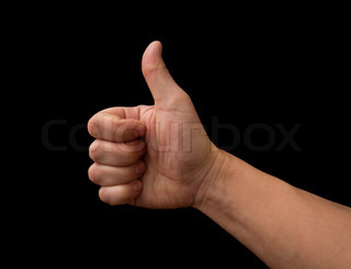 Thumb up hand isolated on black background