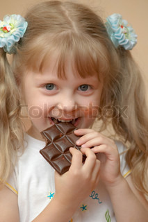A girl eating a chocolate