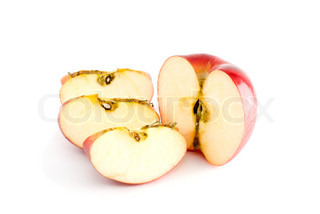 Red apple half and three pieces isolated on the white background