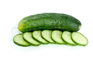 Whole cucumber and few slices isolated on the white background