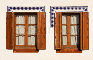 Windows with wooden shutters in the Spanish coastal town