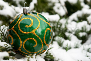 Christmas ball in the snow background