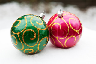 Christmas balls in the snow background