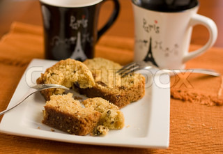 Broken cake on a plate two forks and two cups & Two cakes on the plate shallow depth of field | Stock Photo ...