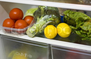 Vegetables on the shelf of the refrigerator