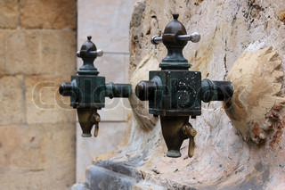 Antique the water tap in the Spanish city