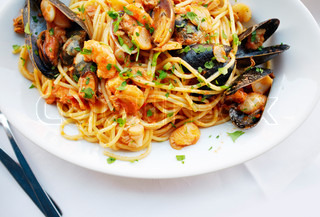 Fresh Seafood pasta - Spaghetti, clams, shrimps and squid, served in a restaurant in Burano, Veneto, Italy