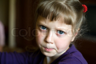 An image of a portrait of a sad little girl