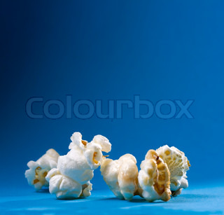 Popcorn on the blue background