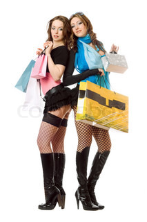 Two attractive young women after shopping. Isolated