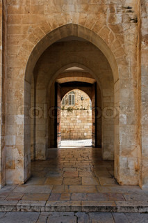 Ancient stone arch leading to pool of Bethesda in Jerusalem Old City
