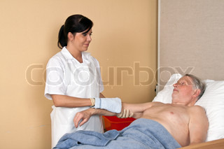 a nurse washes a patient in a nursing home