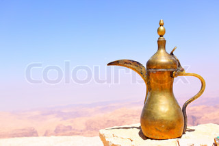 Arabic coffee pot on the stone and Jordan's mountains in the background