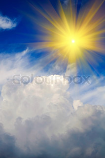 Sun Shining in Sky with Puffy Clouds