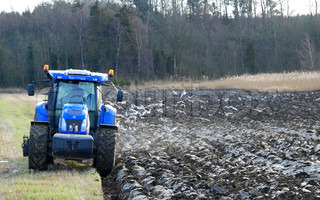 Blue Tractor Ploughing the Field