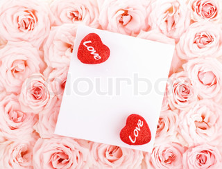 Pink fresh roses background with red hearts & isolatedblank greeting card, love concept