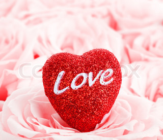 Pink fresh roses background with red heart, love concept image