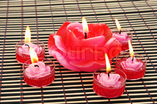 Rose candles on wooden math