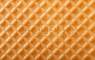Structure of a baked golden waffle background