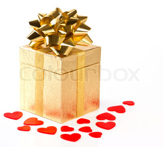 golden gift box with bow and red hearts decoration on white background