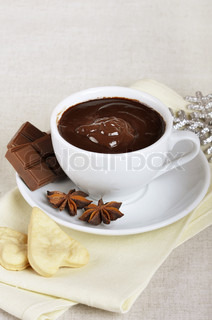 Cup of hot chocolate with anise and cookies | Stock Photo | Colourbox