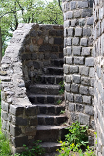 An ancient ladder at the old stone castle