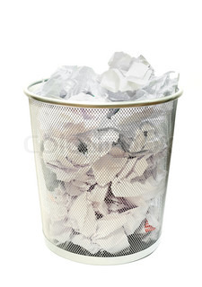 Metal wire wastebasket full of trash on a white background