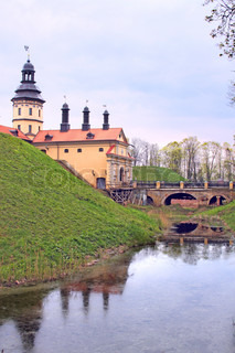 Niasvizh Castle in Belarus and its reflection in a moat