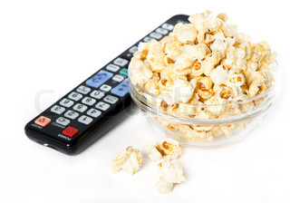 bowl with popcorn and tv remote control on white background