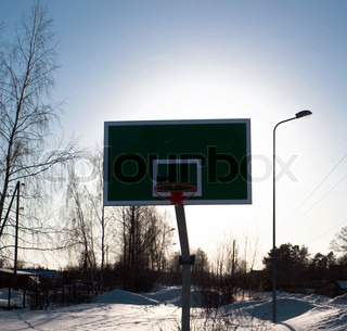 Basketball in winter time on open area