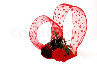 Valentine day bouquet - three different red tint roses with heart shapedribbon isolated on white background