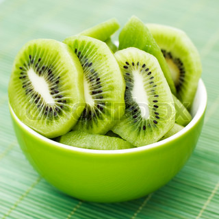 kiwi slices in a small green bowl