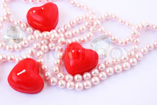 Heart shape red candles, stones and