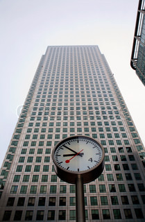 London - clock and facade of Canary Wharf Tower