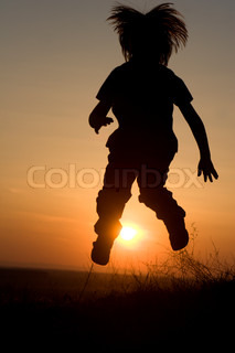 jump of little girl in sunset - silhouette